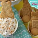 Coconut Cream Pie Cheesecake Dip in a small bowl with dipping crackers with text overlay for Pinterest