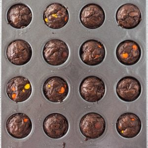 An overhead picture of the baked brownie bites in a mini cupcake pan.