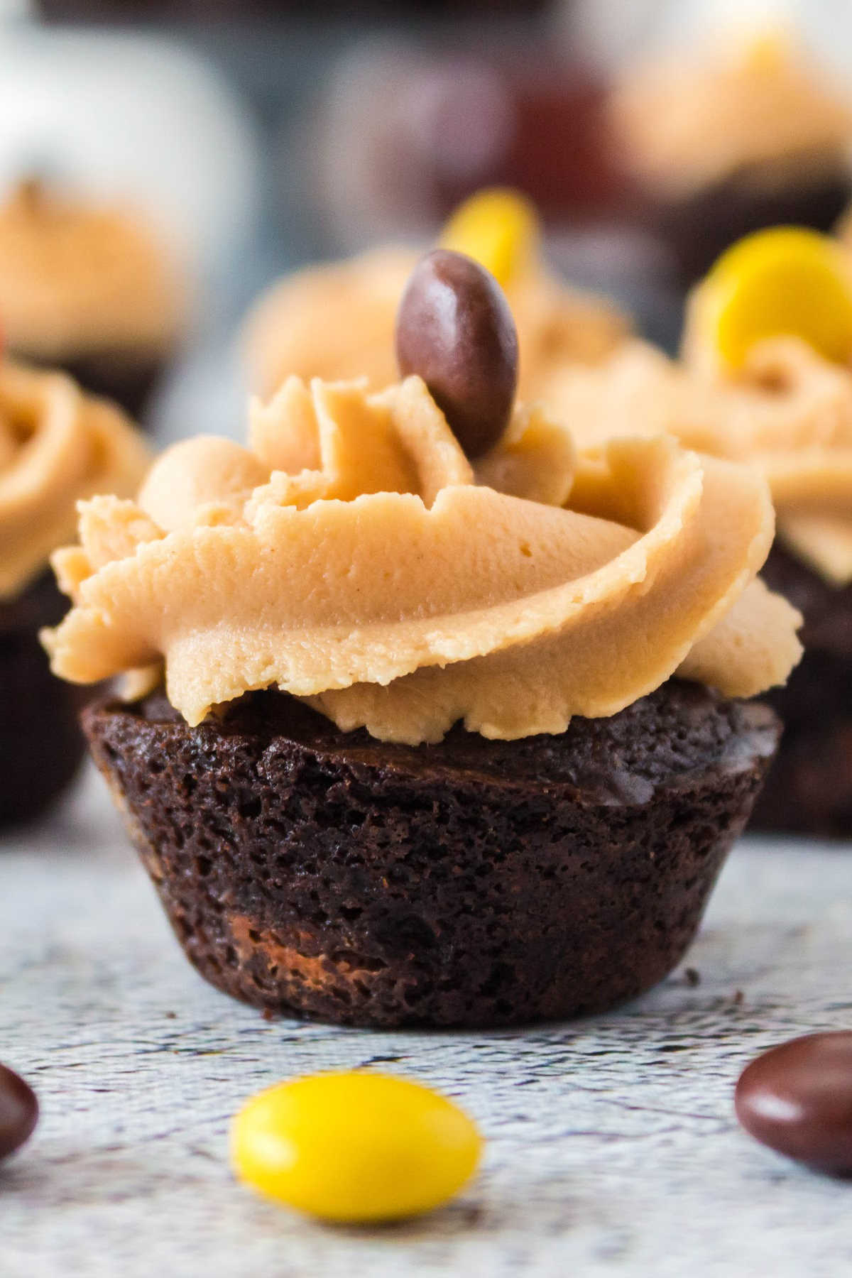 A close up picture of finished brownie bites with peanut butter frosting on them.