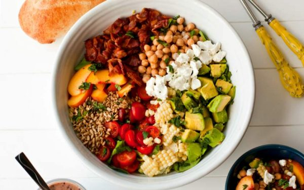 Overhead picture of the finished salad in a white serving bowl.