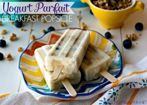 Yogurt Parfait Breakfast Popsicles on a plate with text overlay for Pinterest