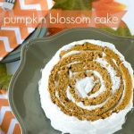 Pumpkin blossom cake on a serving plate with text overlay for Pinterest