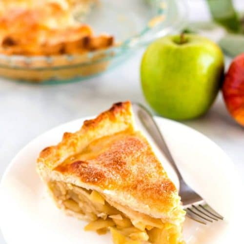 Deep Dish Apple Pie slice on a white plate.
