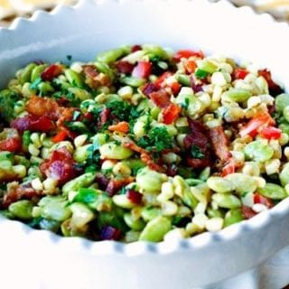 A bowl of Succotash with bacon and scallions