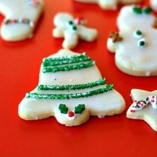 A close up of Porcelain sugar cookies on a red placemat