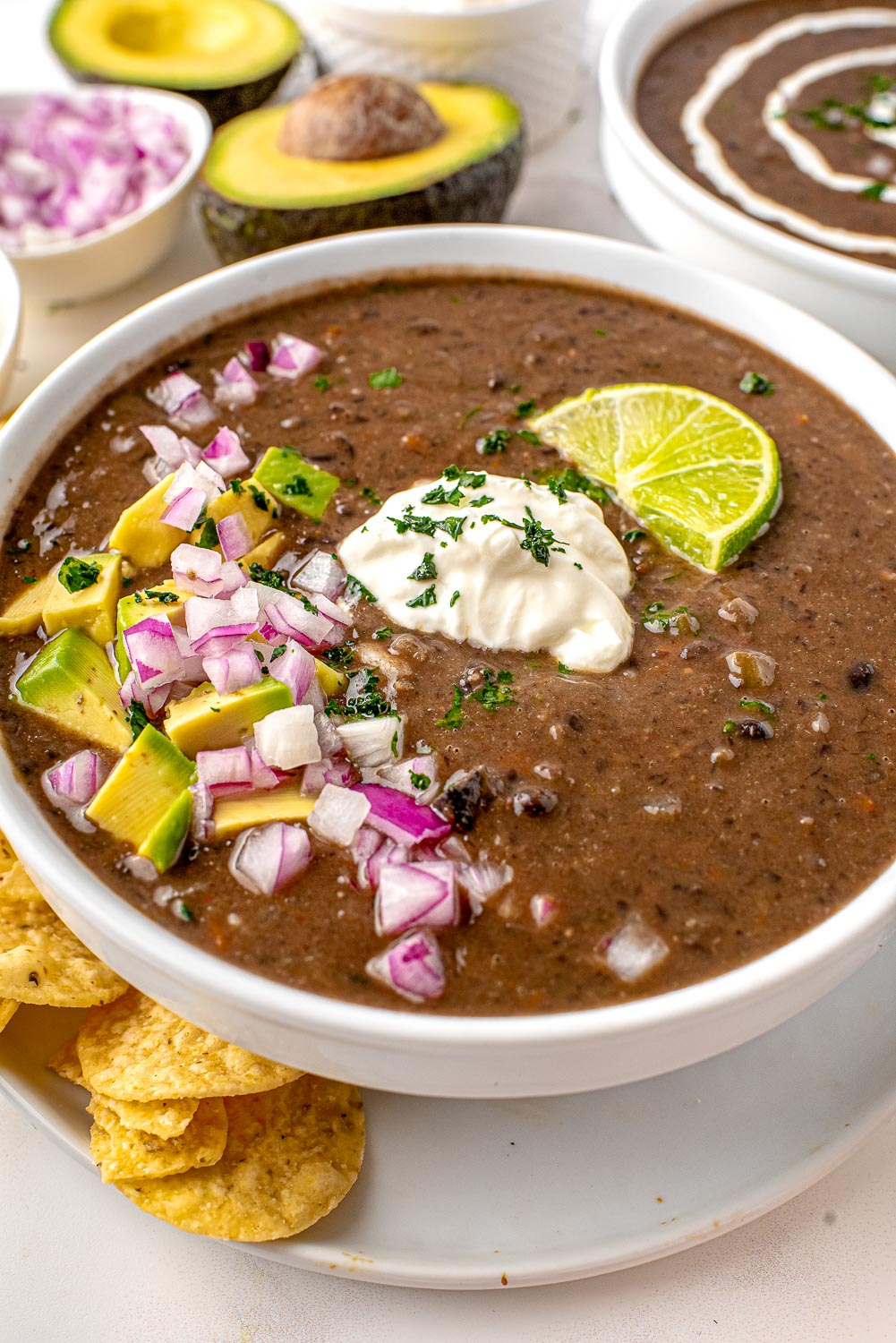 A close up picture of Black Bean Soup in a white bowl.