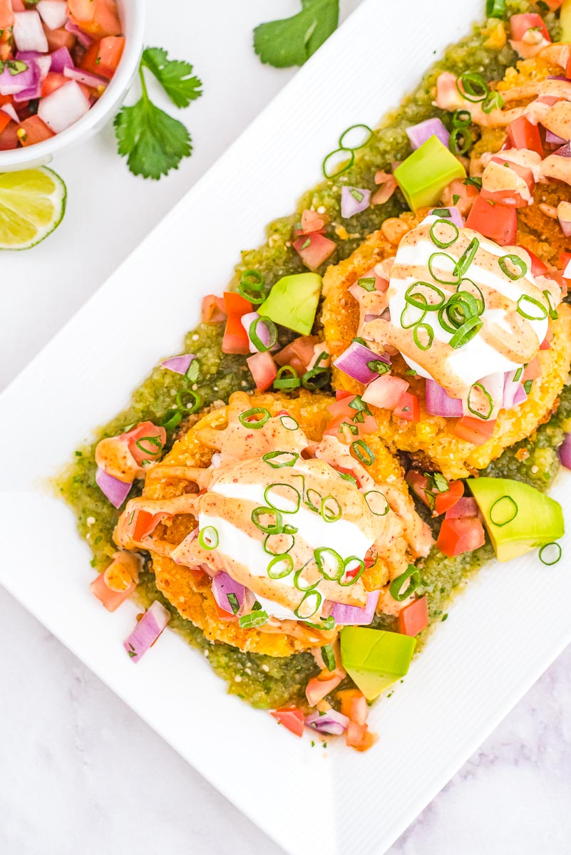 An overhead picture of the finished Sweet Corn Tamale Cakes on a white platter.