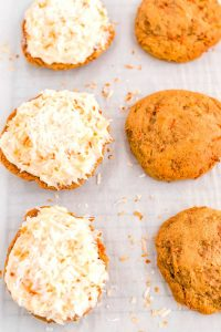 Spread the frosting on the whoopie pies.