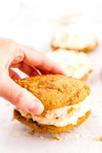 Sandwich the Carrot Cake Whoopie Pies with 2 cakes, and frosting.