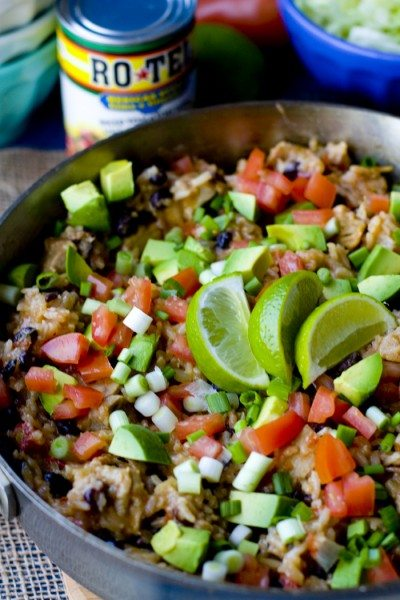 The filling for the burrito bowls in a skillet.
