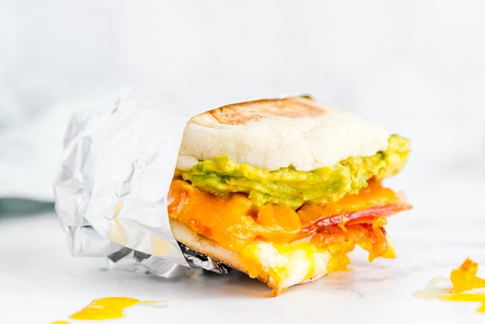 A breakfast sandwich wrapped in foil ready for the freezer.