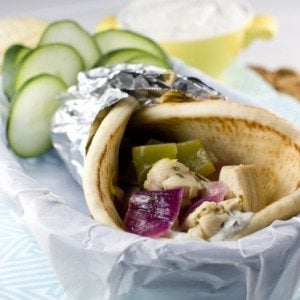 Chicken Souvlaki in a pita on a plate.