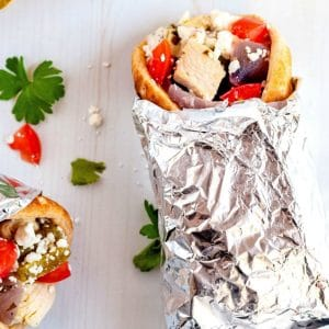 A Chicken Souvlaki pita wrapped up in foil.