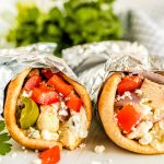 Wrap the pitas up and serve.