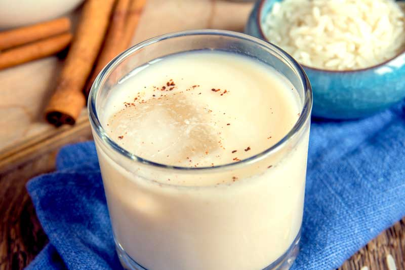 A glass of Horchata on a table