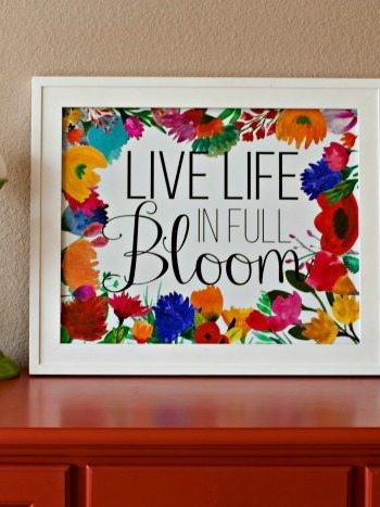 Live life in full bloom printable in a frame on a table