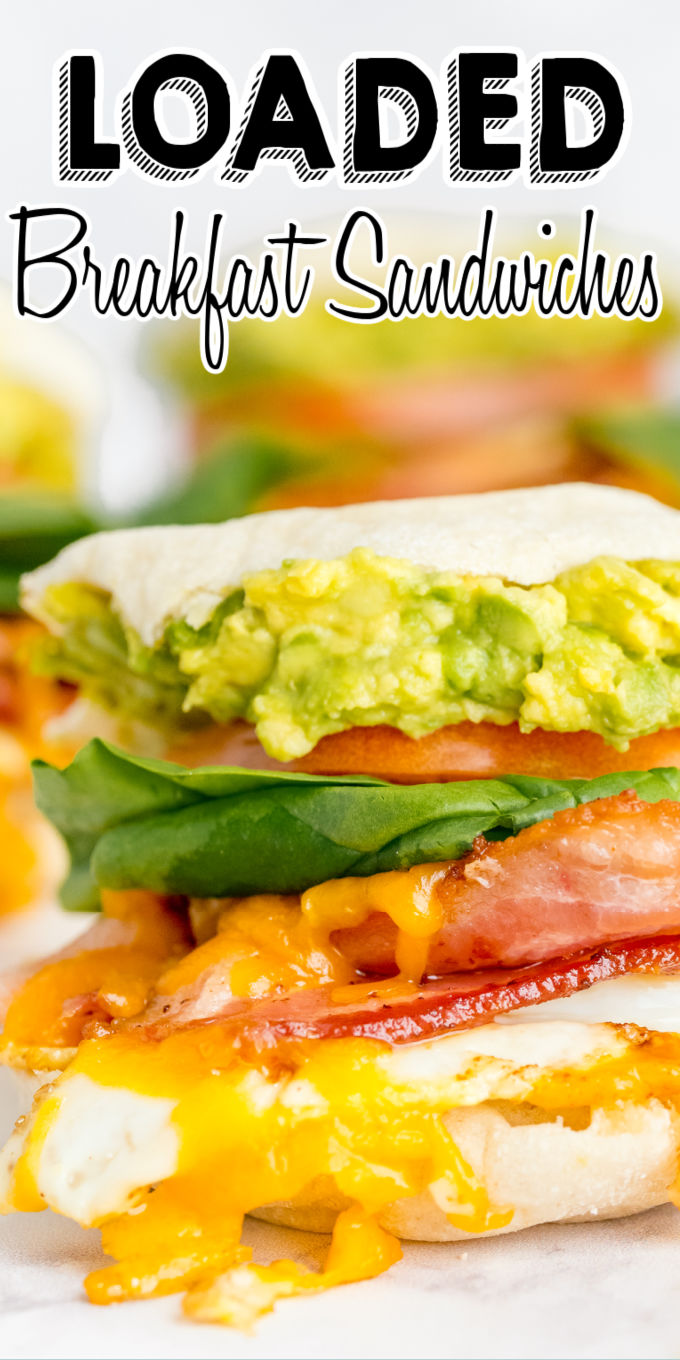 These Loaded Breakfast Sandwiches have eggs, bacon, cheese, avocado, spinach, and tomato. This recipe has freezer instructions, too! via @foodfolksandfun