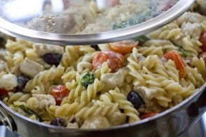 One-pot greek pasta with lemon chicken in a large skillet