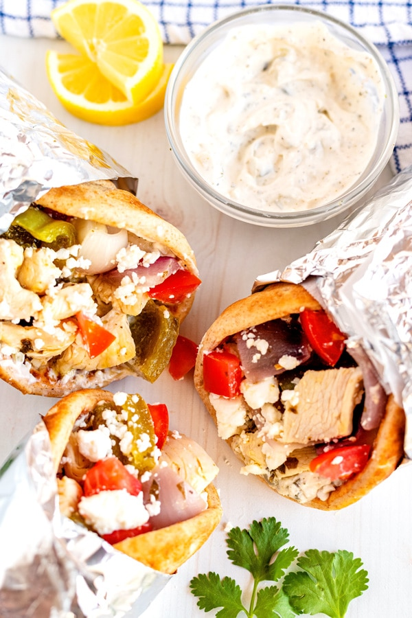 A close up overhead picture of Chicken souvlaki in pitas.