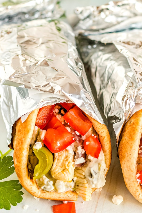 Chicken souvlaki wrapped up in a pita.