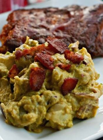 Bacon and Avocado Potato salad on a plate with bacon pieces on top