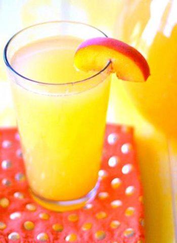 A close-up of a glass of Peach Lemonade