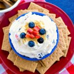 Fruit Spangled Cheesecake Dip in a bowl on a plate with graham crackers