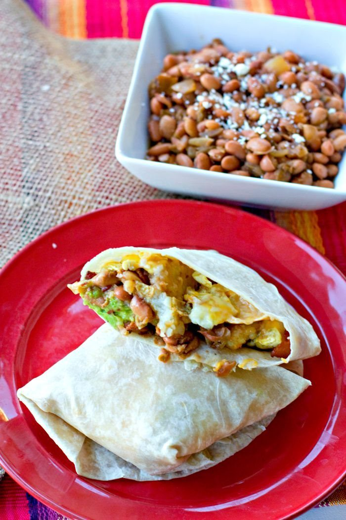 Breakfast Burrito on a plate with Pinto Beans on the side