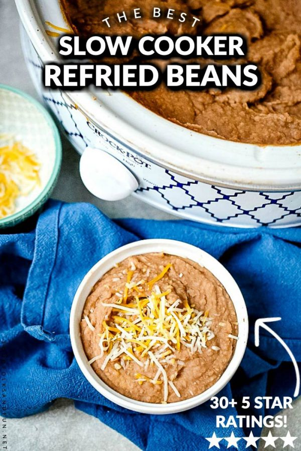 Crockpot refried beans in a white bowl with text overlay for Pinterest.