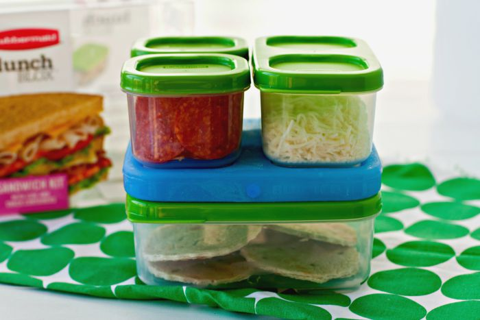 Lunch box pizzas packed in Tupperware containers