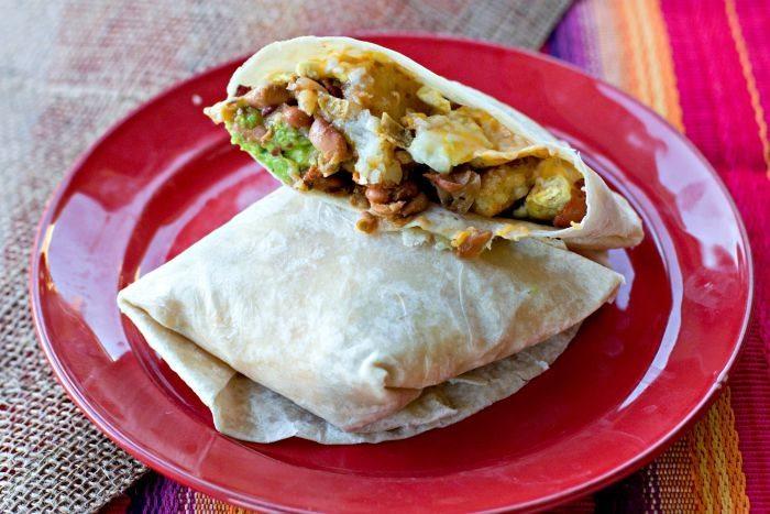 A mega breakfast burrito on a plate