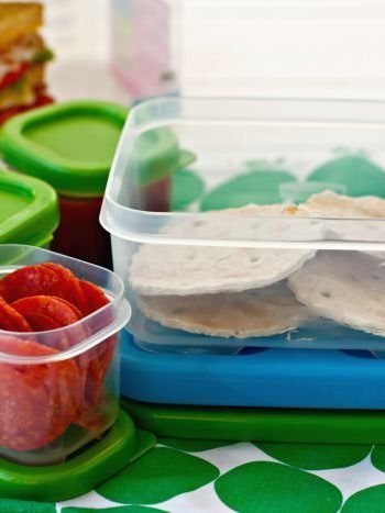 Ingredients needed for making lunch box pizzas in Tupperware containers