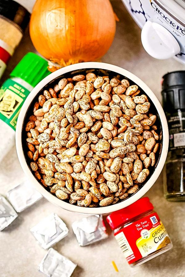 All of the ingredients needed to make these slow cooker refried beans.