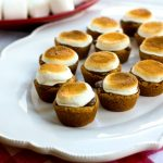S'mores Cookie Bites  on a serving platter with marshmallows in the background