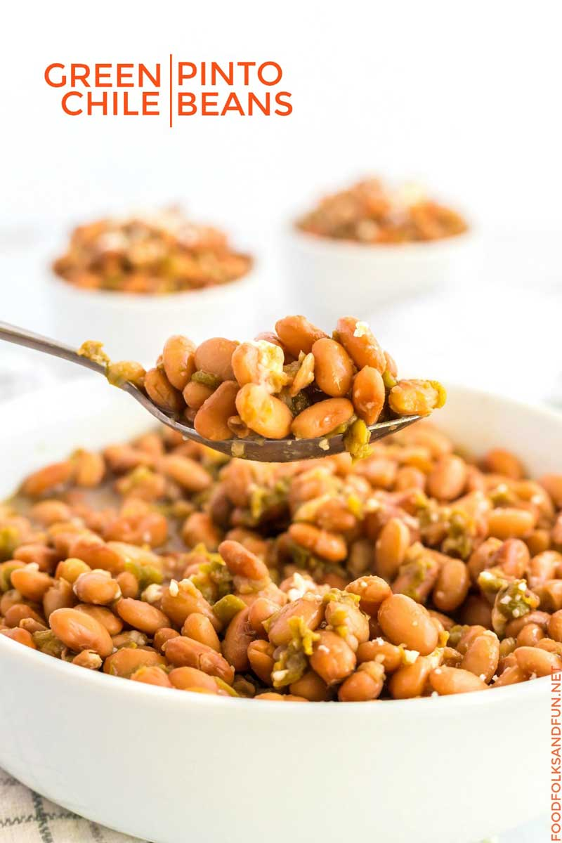 A spoonful of slow cooker green chile pinto beans.