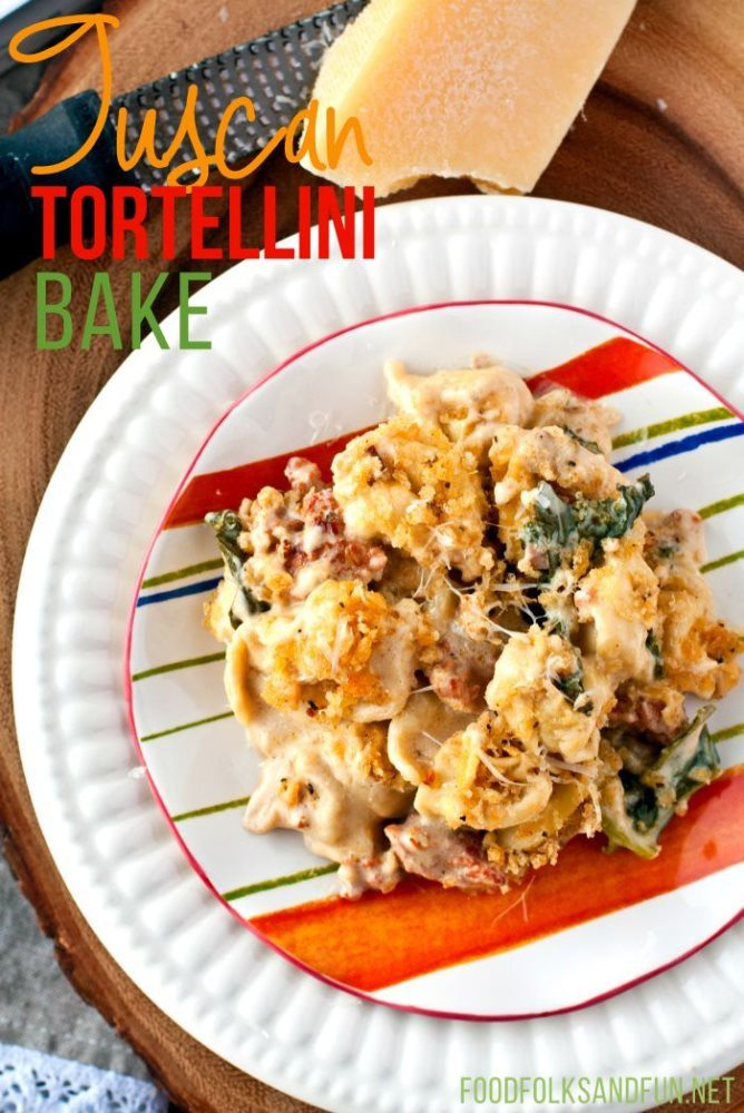 Top view of Creamy Tuscan Tortellini Bake on a plate with text overlay for Pinterest