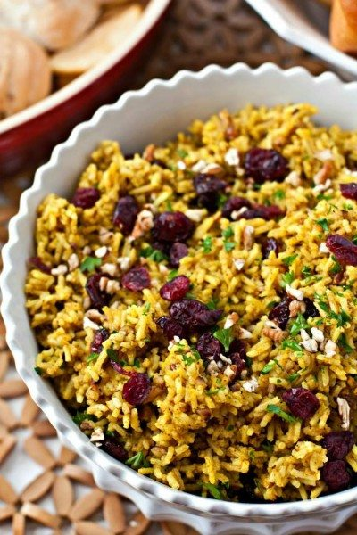 Cranberry Curry Rice in a white serving bowl.