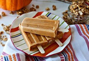 Pumpkin Parfait Breakfast Popsicles on a plate