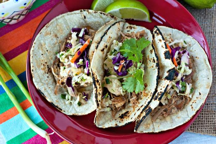 This Sweet Chipotle Pork Tacos recipe is an easy slow cooker recipe that is flavorful and a real crowd-pleaser!