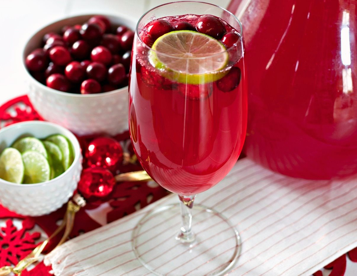 Make this Cranberry Limeade Sparkling Mocktail recipe for your next holiday party. It's to perfect festive mocktail for Christmas and New Year's!