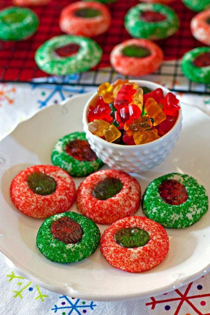 These Gummy Bear Thumbprint Cookies help spread holiday cheer with simple surprises. They're an easy Christmas cookie recipe that are so tasty! Grab the kids-they'll love making them, too!