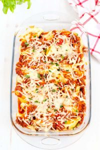 Pan of stuffed shells covered in cheese.
