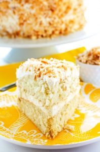 This Coconut Cream Cake is so tender and deliciously covered in Coconut Swiss Meringue Buttercream and beautifully toasted coconut.
