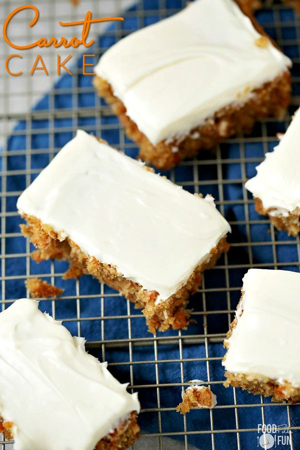 Frosted pieces of carrot cake on a wire rack