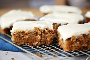 Sliced pieces of carrot cake on a wire rack