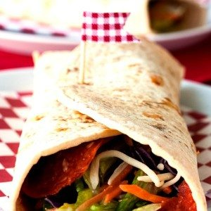 A Pizzeria Salad Wrap is a pepperoni pizza meets your favorite Italian salad in wrap form. Basically it's your family's new favorite quick and easy meal!