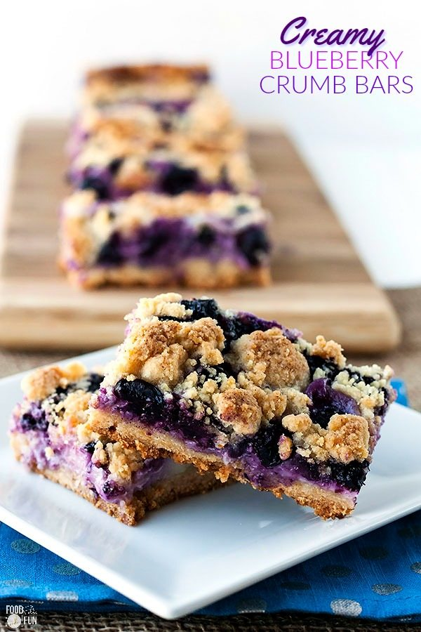 2 blueberry bars on a plate with 3 in the background.