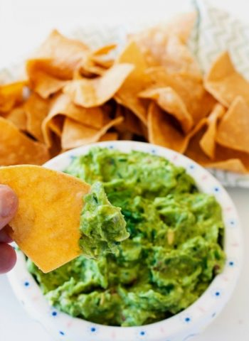 This quick and easy Garden Veggie Guacamole recipe is full of fresh vibrant ingredients like shallots, bell peppers, dill and chives.
