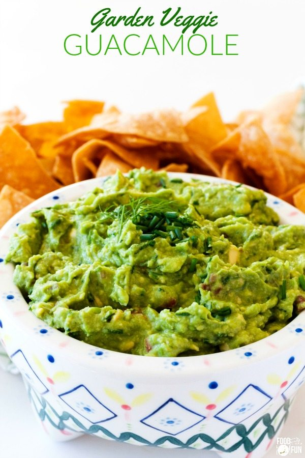 Garden Veggie Guacamole in a bowl with chips in the background