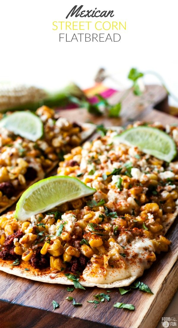 A close-up of Mexican Street Corn Flatbread Pizza with limes on top